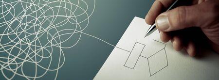 Expert business hand solving tangled line, outside the paper sheet on a blue desk