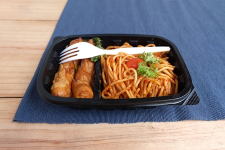 spaghetti tomato sauce with Sausage in Food box on a wooden table