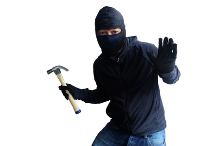 Masked thief with hammer isolated on white background Banco de Imagens