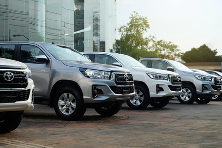 Bangkok, Thailand - May 13, 2018 Row of New Pickup Trucks For Sale, Toyota Hilux Revo 2018 at showroom Editorial