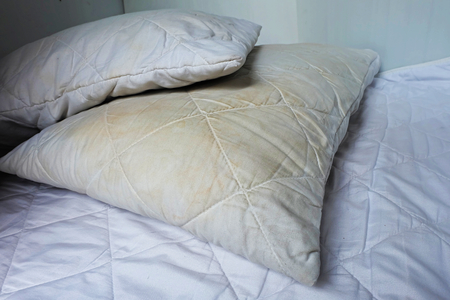 Dirty pillows on white beds are a source of germs and dust mites and mattresses