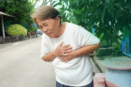 Elderly asian woman with chest pain with heart attack 写真素材 - 111989049