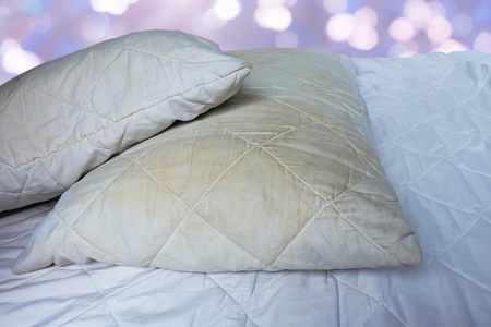 Dirty pillows on white beds are a source of germs and dust mites and mattresses.