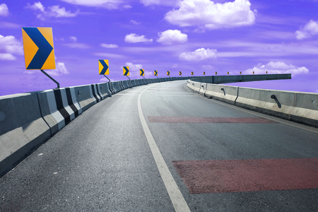 Right turn sign to the end of the empty highways road and blue sky background, helpless and reach a dead end or no way concept 写真素材