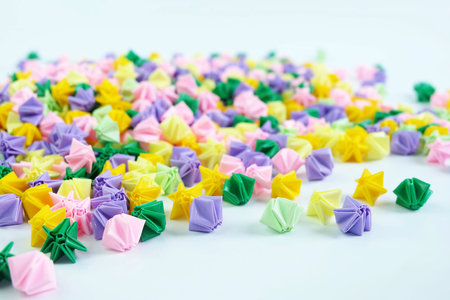 Colorful origami stars or flowers folding paper,on white background
