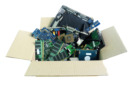 Paper box with Computer Hardware part electronic waste isolated on white background Stock Photo