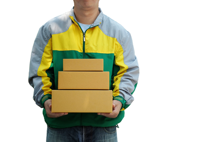 Delivery man staff in the colorful jacket uniform holds parcel box that is about to be delivered to customer isolated on a white background, with copy space Banco de Imagens
