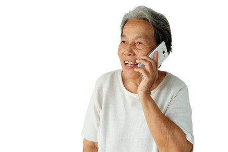 Portrait of elderly asian woman are using mobile phone with a smile isolated on white background, Communication technology for happy and good mood concept