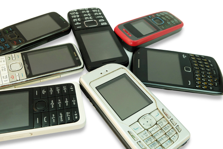 Old mobile phones isolated on a white background