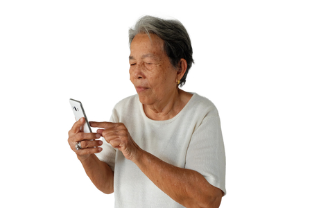 Elderly asian woman are holding and looking mobile phone with poor eyesight isolated on white background, Hyperopia or Poor eyesight concept