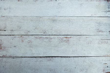 Old wooden plank floors and cracked, painted white, faded, Vintage wooden background