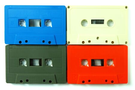 Collection of colorful old audio cassette tape isolated on a white background Imagens