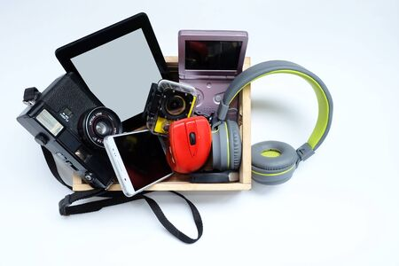 Many used modern Electronic gadgets for daily use in wooden cases on a white background, Reuse and Recycle concept.
