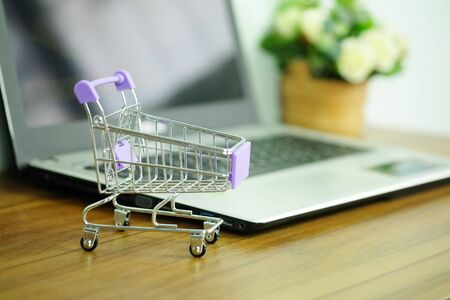 Shopping cart and laptop computer, Concepts online shopping where consumers can buy products directly from home or work