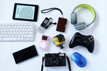 Many used modern Electronic gadgets for daily use on White floor, Reuse and Recycle concept, Top view