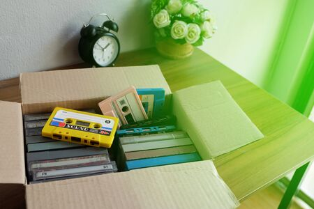 Old audio cassette tape in the old paper box on the desk 스톡 콘텐츠 - 139937644