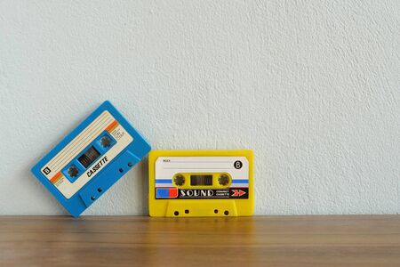 Old colorful cassette tape on wooden floor and leave blank space above for text input