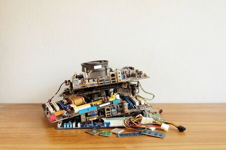Pile of Motherboard computer, electronic equipment, Printed Circuit Board and orther broken or damage on wooden floor, Electronic waste problems, Environmental pollution 스톡 콘텐츠 - 138032281