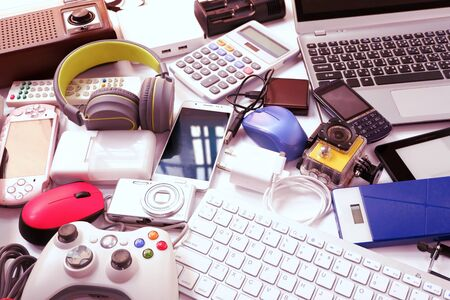 Many used modern Electronic gadgets for daily use on White floor, Reuse and Recycle concept.