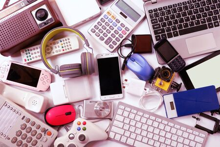 Many used modern Electronic gadgets for daily use on White floor, Reuse and Recycle concept 스톡 콘텐츠 - 141027408