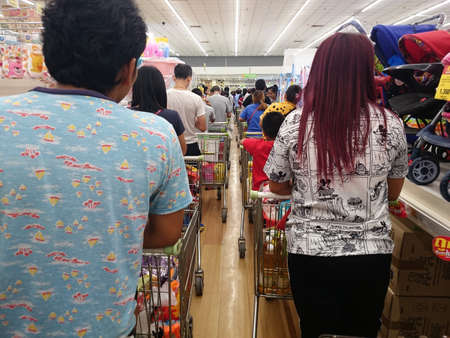 Bangkok, Thailand - October 10, 2019 : Many people are shopping in supermarkets push the shopping cart, line up in the queue to shop in the mall. 에디토리얼