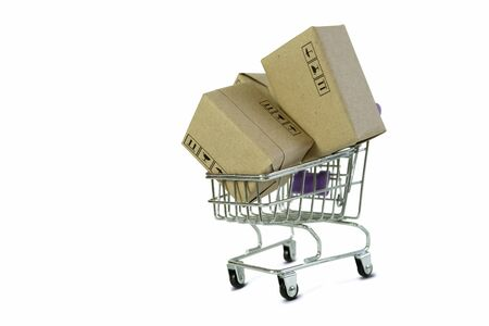 Shopping cart with Parcel box Products isolate on white background. Online shopping from home and delivery service business with copy space