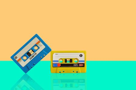 Old colorful cassette audio tape on pastel color background, and leave blank space above for text input 스톡 콘텐츠