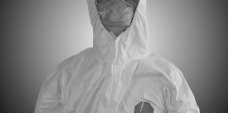 Medical personnel in half protective clothing uniform PPE suit and Surgical mask or hygienic mask N95 In the dark theme background, During coronavirus covid-19 outbreak, Concept of pandemic covid19 virus 스톡 콘텐츠