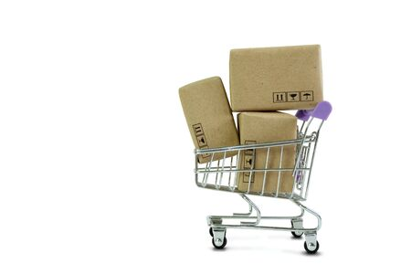 Shopping cart with Parcel box Products isolate on white background. Online shopping from home and delivery service business with copy space.