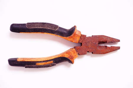 Old vintage rusty iron pliers on a white background 스톡 콘텐츠 - 151465487