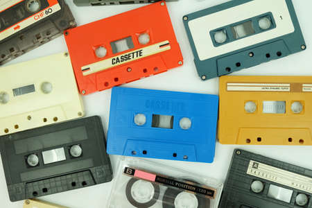 Collection of colorful old audio cassette tape isolated on a white background 에디토리얼