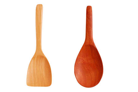 Wooden ladle and wooden spatula isolated on white background. Concept of reducing the use of plastic containers has turned to environmental protection containers.