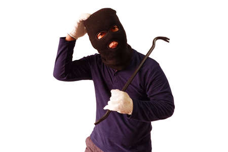 Masked thief holds steel crowbar in preparation for a pry, turned to look with a doubtful expression Isolated on white background Banque d'images