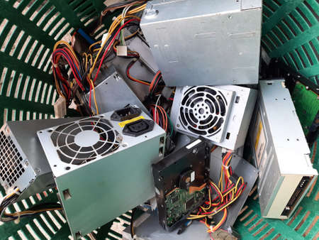 Old Power supply and hard disk dive computer hardware accessories in the basket, Obsolete equipment is electronic waste Reuse and Recycle concept.