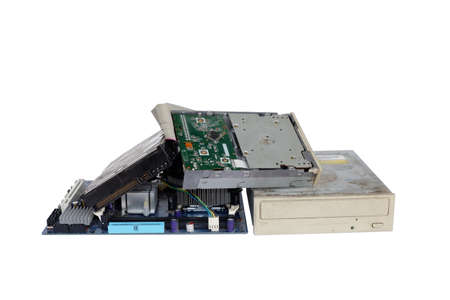Pile of electronic waste, Rusty old and obsolete computer hardware such as motherboards and CD-ROMs, floppy disk isolated on white background