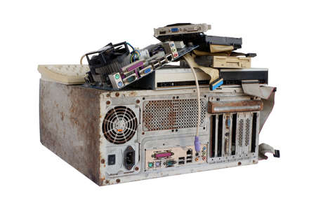 Pile of electronic waste, Rusty old computer cases and obsolete computer hardware such as motherboards and CD-ROMs, floppy disk isolated on white background