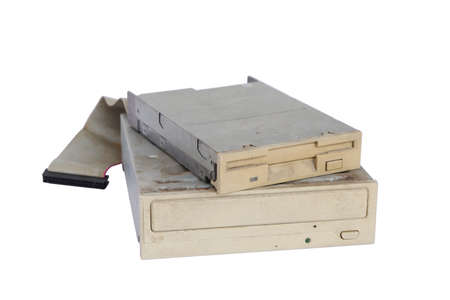 Pile of rusty, old and obsolete computer hardware, like a CD-ROM, floppy disk, isolated on a white background 스톡 콘텐츠