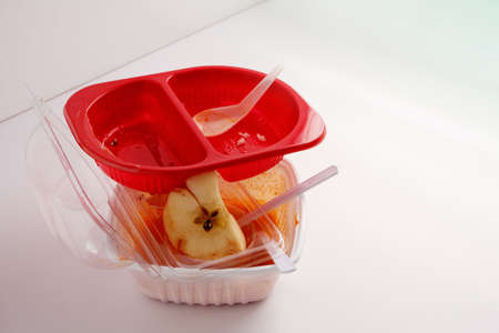 Used food box, disposable plastic containers on white background