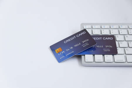 Credit card on computer keyboard on white desk. with copy space for text. Concept of Online shopping and payment.
