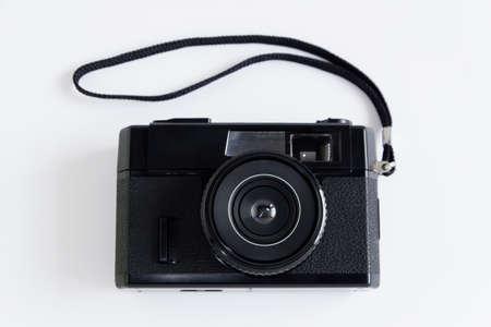 Old classic retro black film camera on white