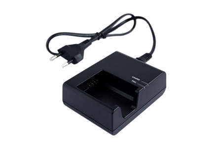 Camera battery charger with power cable isolate on white background 스톡 콘텐츠
