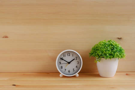 Table clocks and flower vases on wooden desk. with copy space for text. 스톡 콘텐츠
