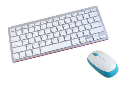 White wireless keyboard and mouse isolated on wooden background