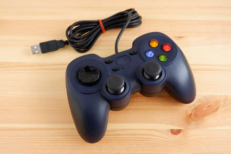 Usb wired joystick controller isolated on wooden background