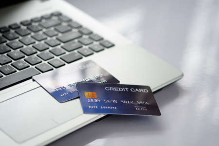 Credit card on laptop computer on white desk. Concept of Online shopping and payment. 스톡 콘텐츠