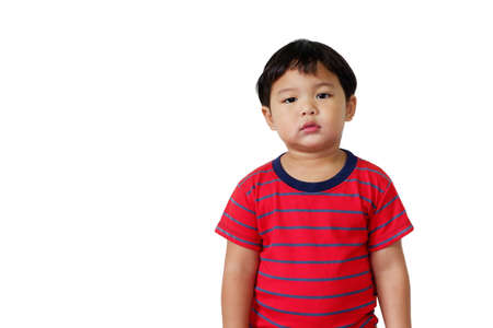 Cute Asian boy wearing bright red striped t-shirt standing on white background. With copy space for text.
