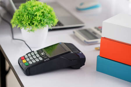 Card swipe machine on the table for customers using credit cards. cashless technology.