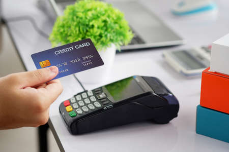 Customers who pay with smartphones with NFC technology, with a card swipe machines and cashless technology. 스톡 콘텐츠