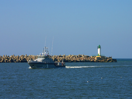 Lighthouse and patrol boat photo
