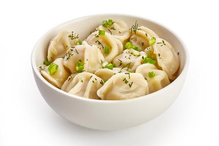 Bowl with tasty dumplings Stock Photo